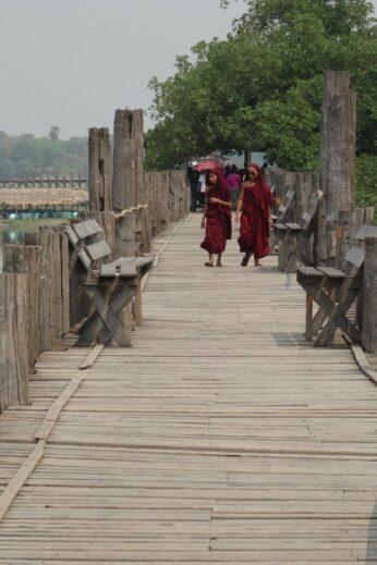 Monks walking on a bridge - InsideBurma Tours