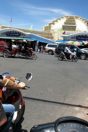 Travelling to Phsar Thmey market on the back of a motorbike