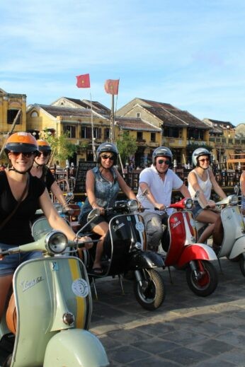 Our Vespa tour on the banks of the river, ready to head out on our Streets & Eats adventure