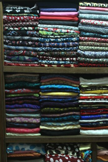 Stacked silk at a Hoi An tailor shop