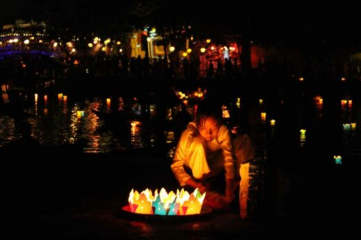 Casting lanterns on the river at Hoi An Lantern Festival