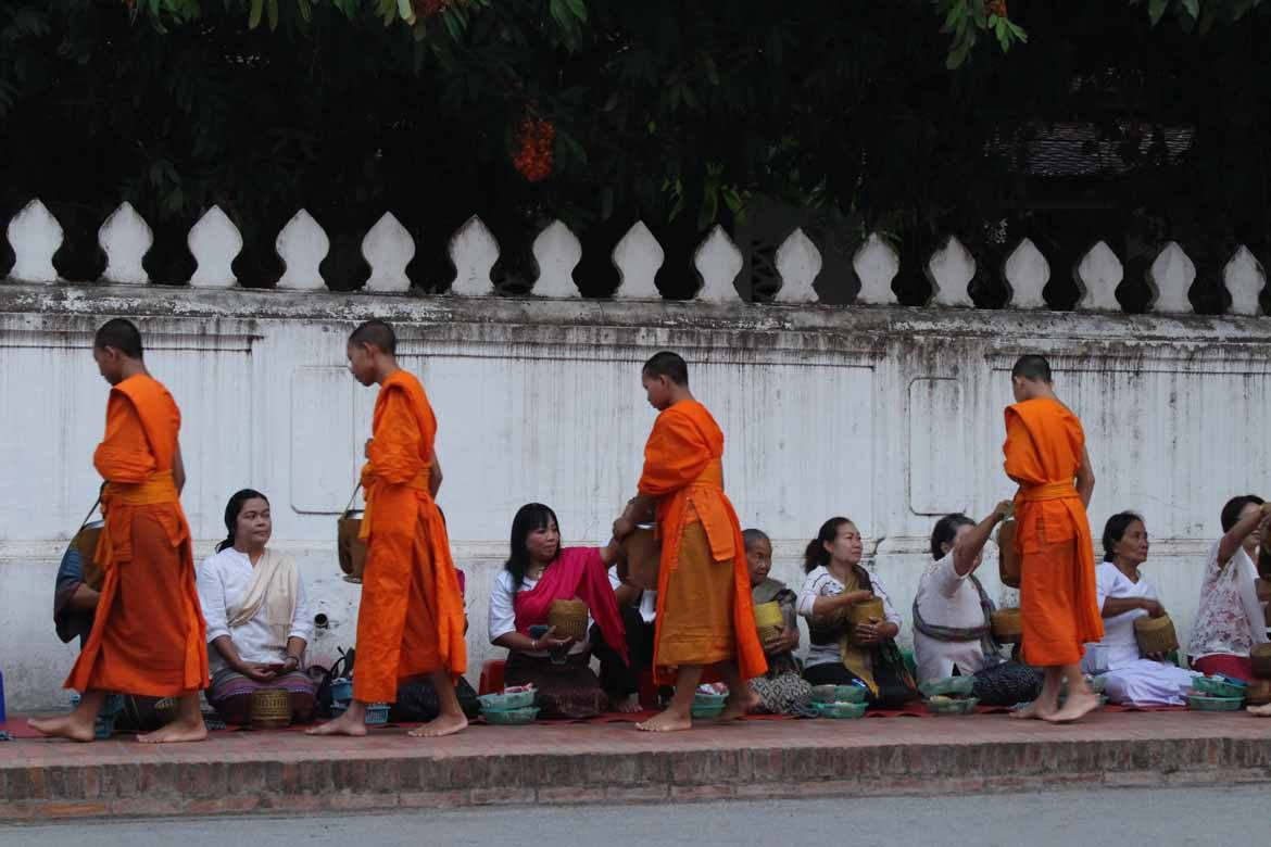 Making offerings of rice is part of Luang Prabang's age-old tradition
