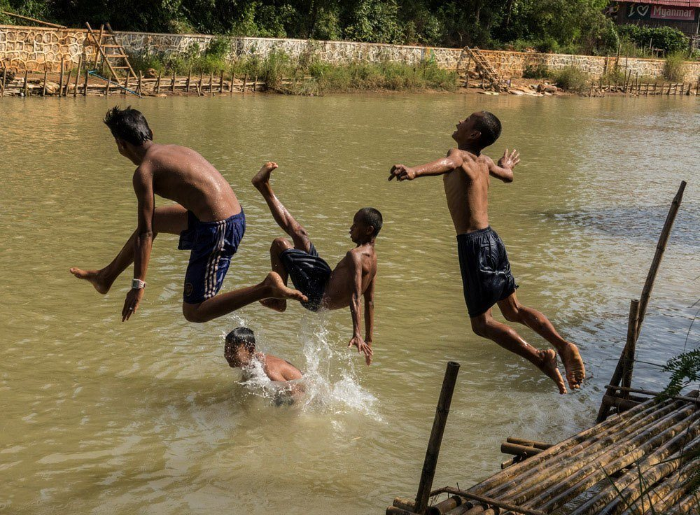 Travel Photography Competition - Children having jumping into lake in Burma