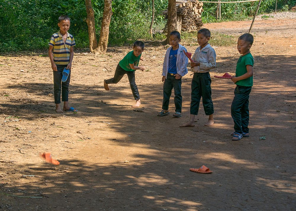 Travel photography competition - Hmong boys playing slipper