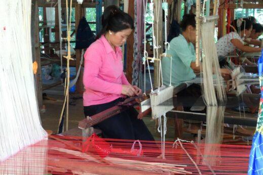 A lady weaving in Ock Pop Tok Luang Prabang, Laos