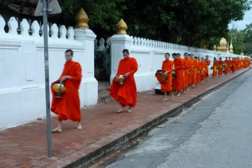 Monks in orange robes in Luang Prabang, Laos
