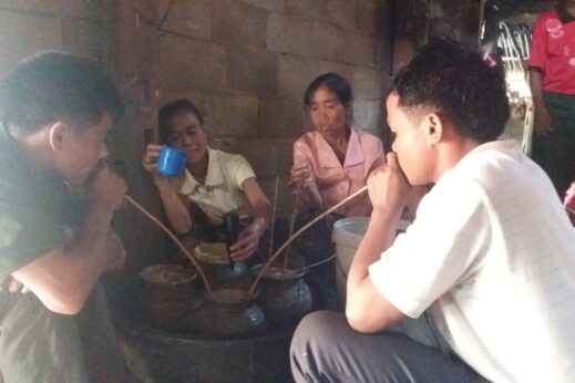 Barci ceremony with villagers drinking rice wine in Laos