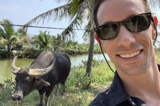 Tyler making friends with a buffalo in Hoi An, Vietnam