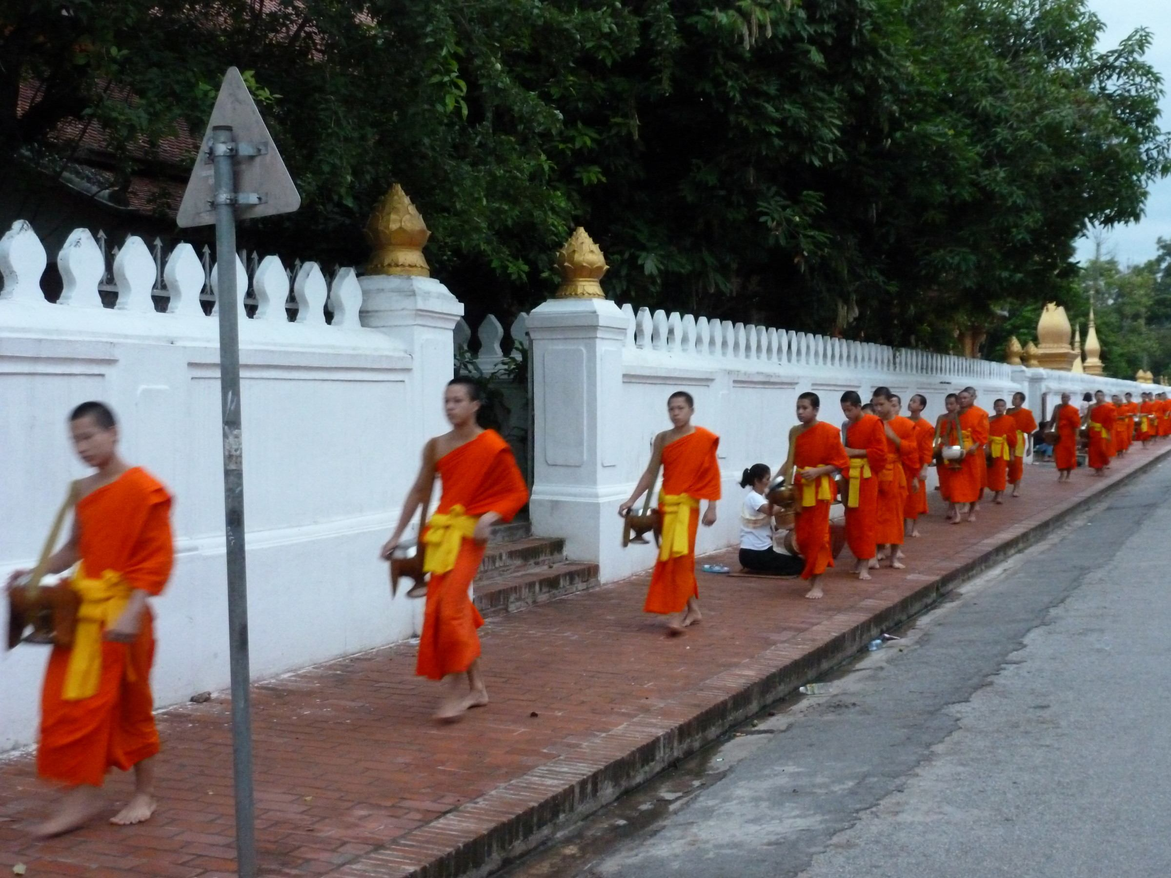 Young monks alms giving