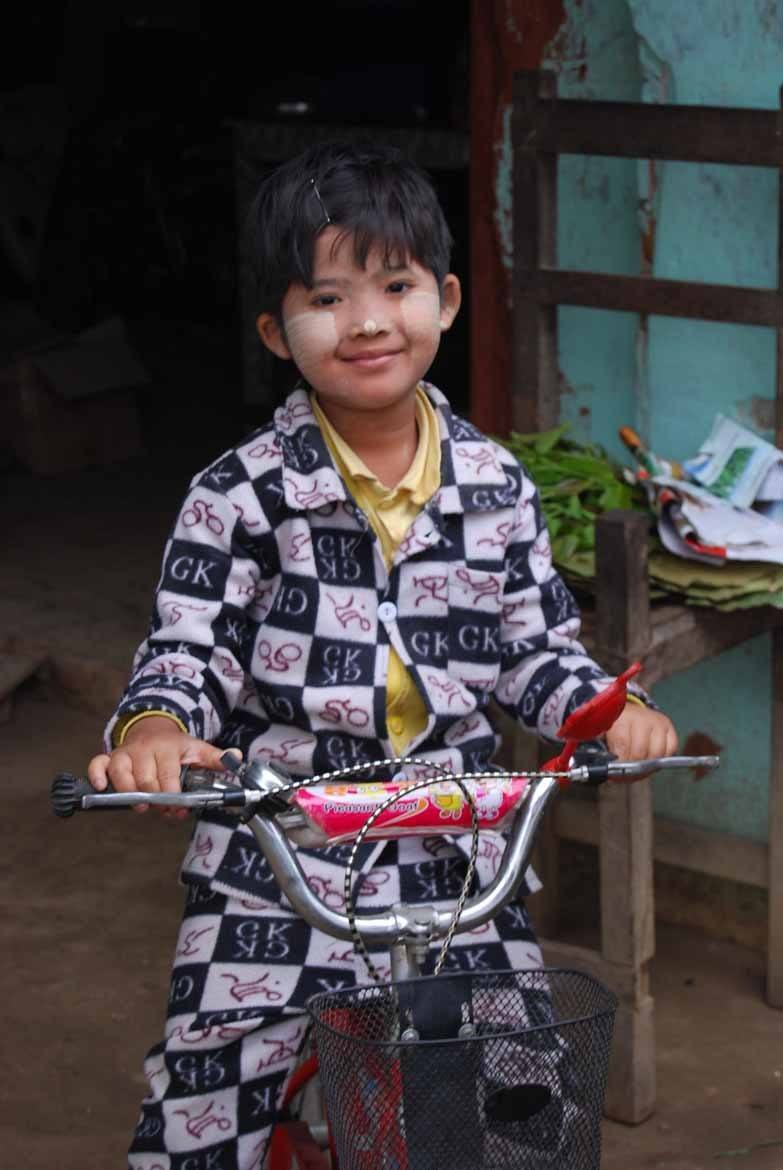 Burmese child on a tricycle