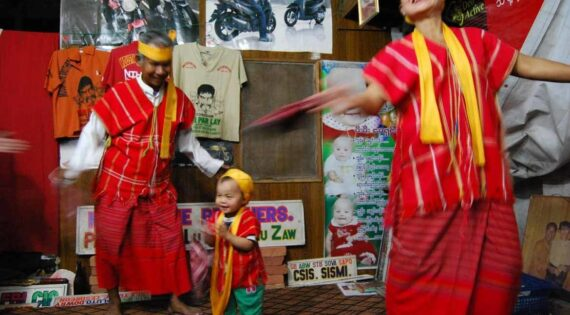 Lu Zaw performing with family members at the Moustache Brothers' home