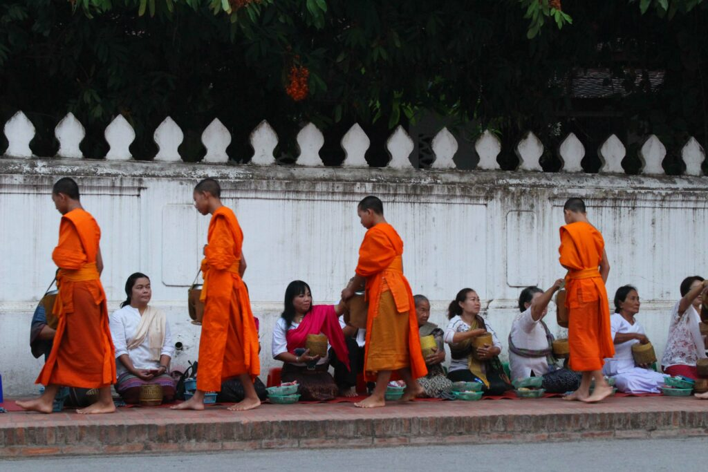 monks collecting alms in Luang Prabang, Laos
