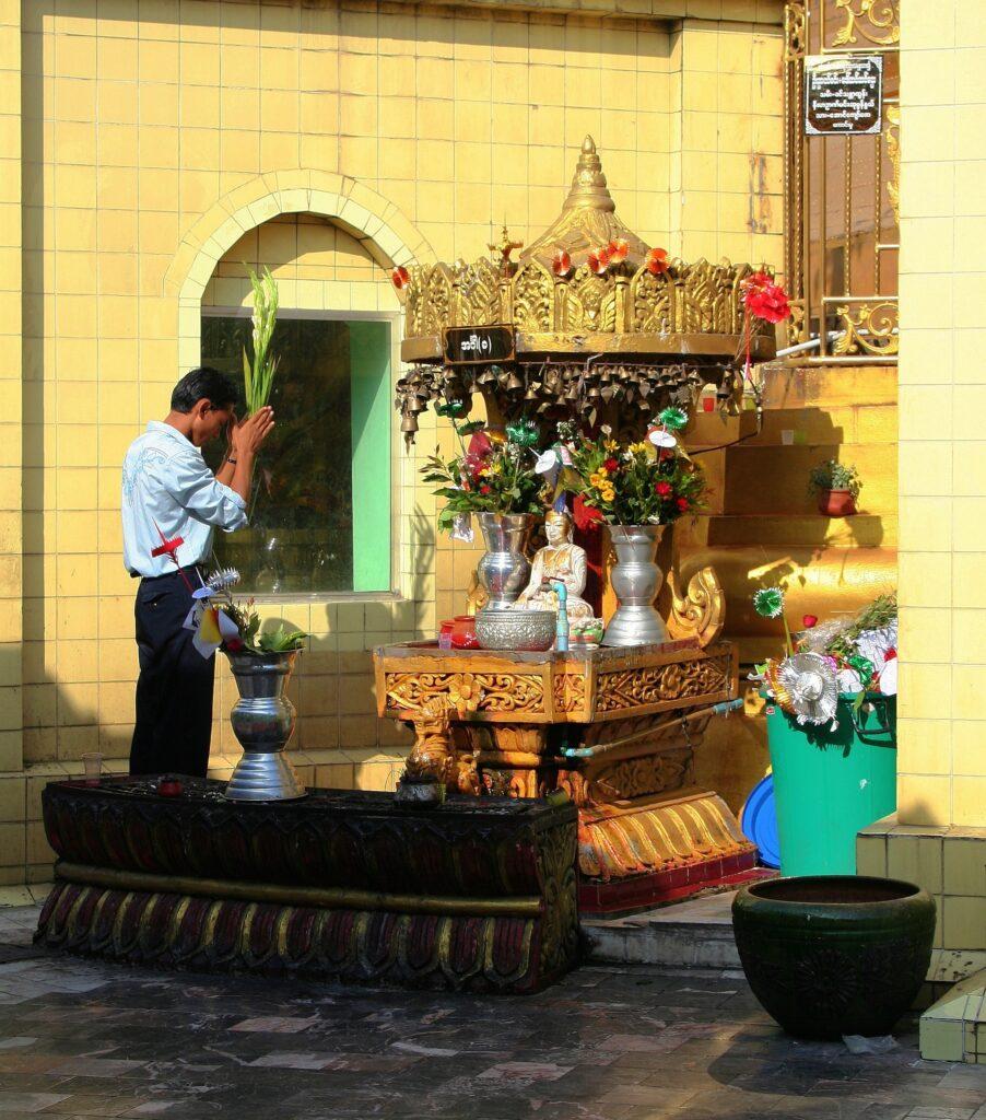 Man praying in Sule Pagoda Yangon, Burma (Myanmar)