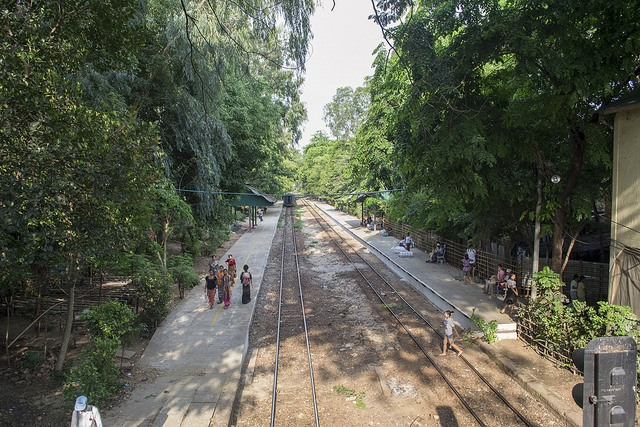 People strolling by the tracks next to Yangon's circle train, Burma (Myanmar)