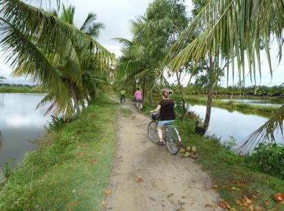 Cycling along the banks of the Thu Bon River near Hoi An