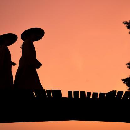 Figures in local garb at dusk