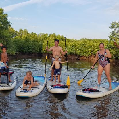 Family paddleboarding in Kampot