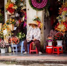 Vietnam woman at market wearing a face mask