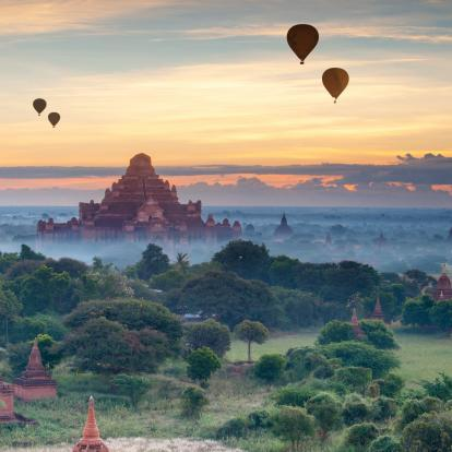 Hot air balloons flying over the plains of Bagan