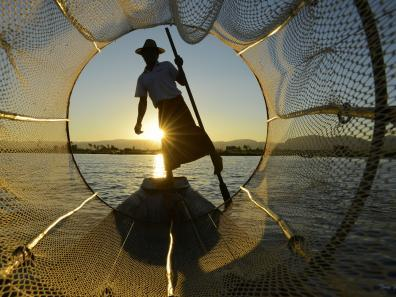 Fisherman on Inle Lake at sunset
