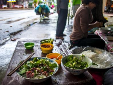 Eating Pho on the streets of Hanoi