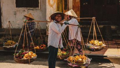 Women carrying bananas in Vietnam
