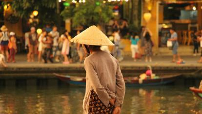 A woman in a conical hat in Hoi An